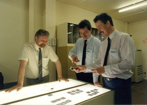 """Left to right: David Blackwell, Ron Campbell, Geoff Binks, 1984. Selecting images from the """"Slide library""""."""