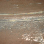 Grooves developed due to abrasive materials