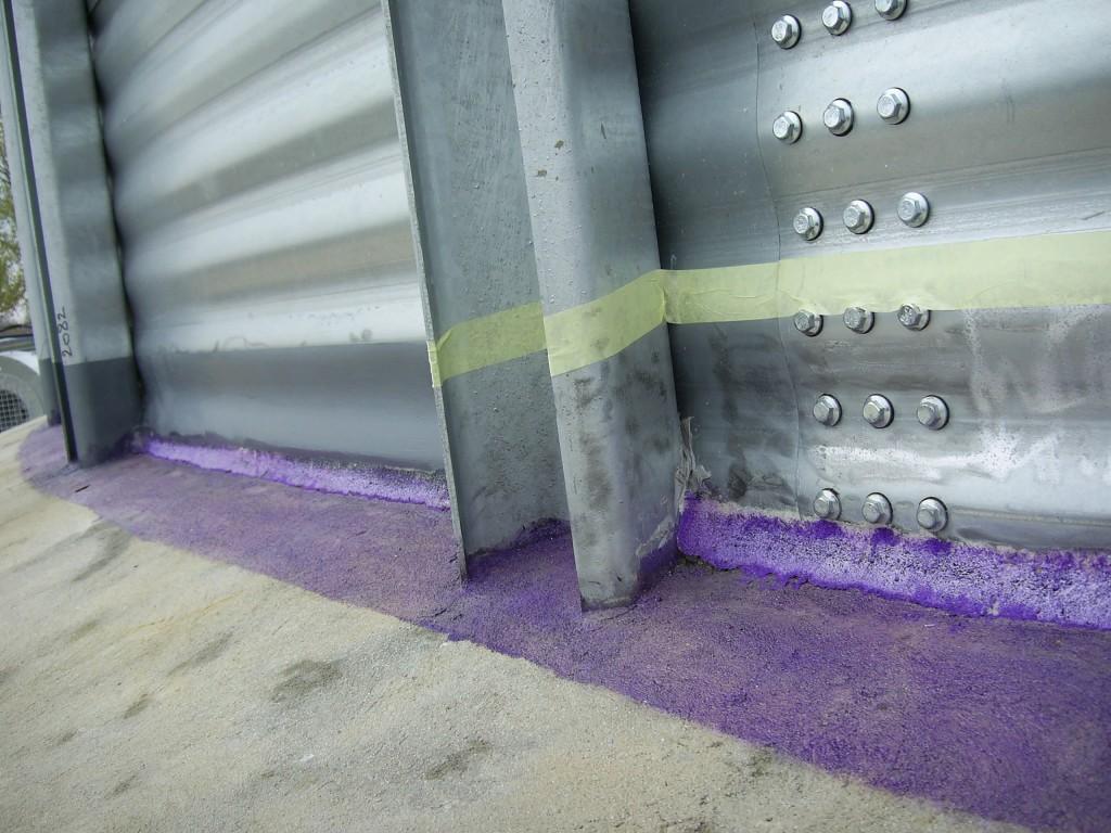 Belzona surface primer applied to concrete tank base before sealing