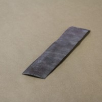 Abrasive paper (painted surface) or wire brush (corroded surface)