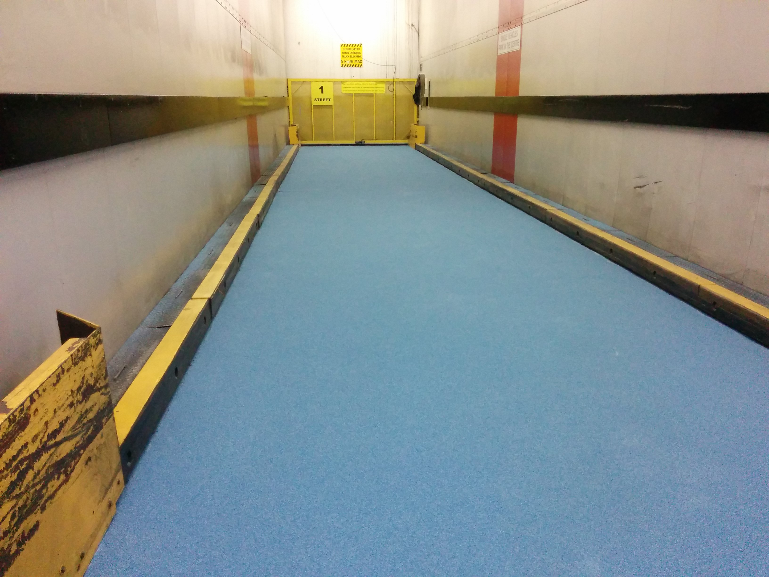 Commercial truck lift floor repair and protection at a high rise - airport facilities maintenance