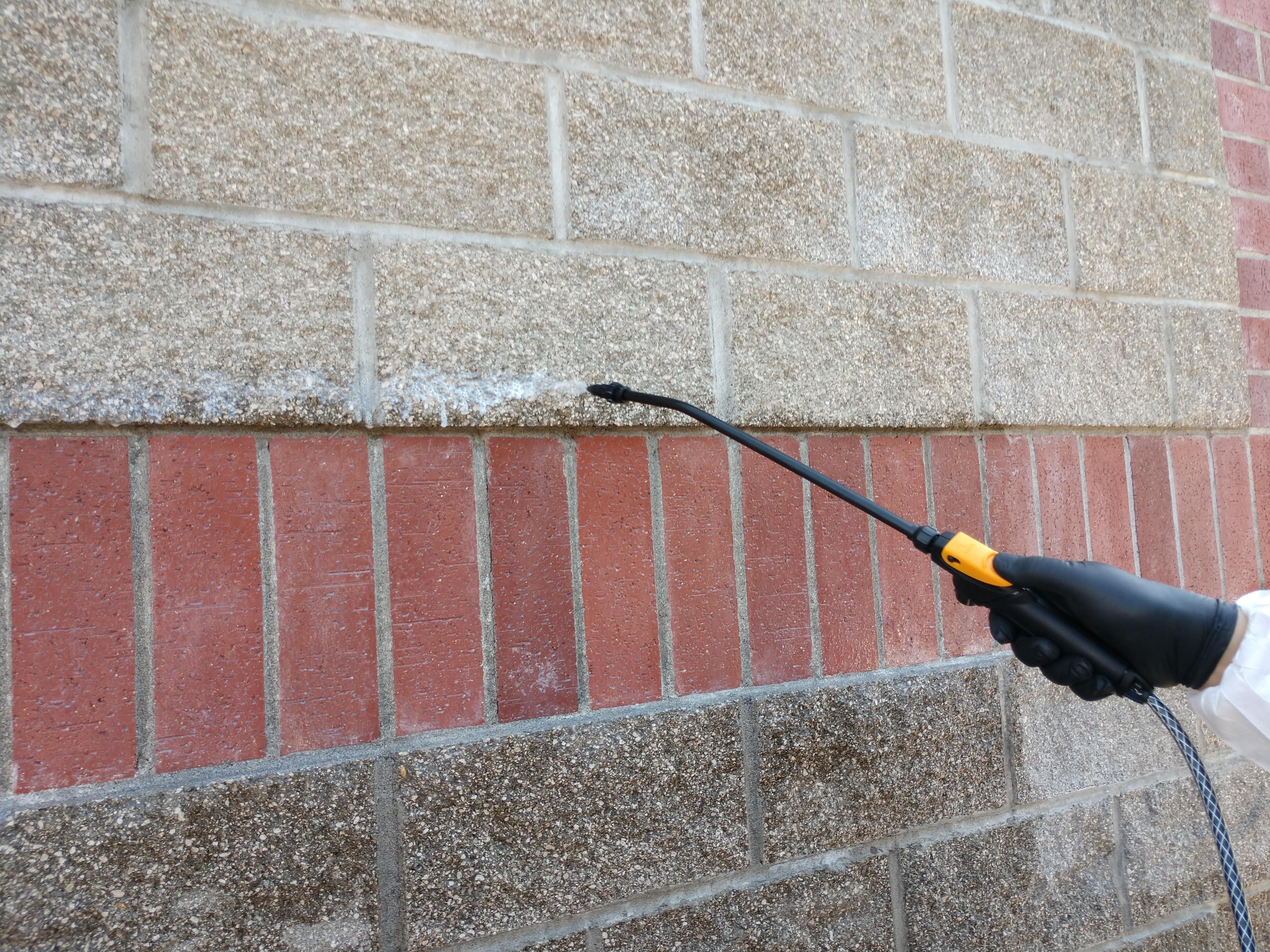 Waterproofing a brick wall at a stadium - airport facilities maintenance