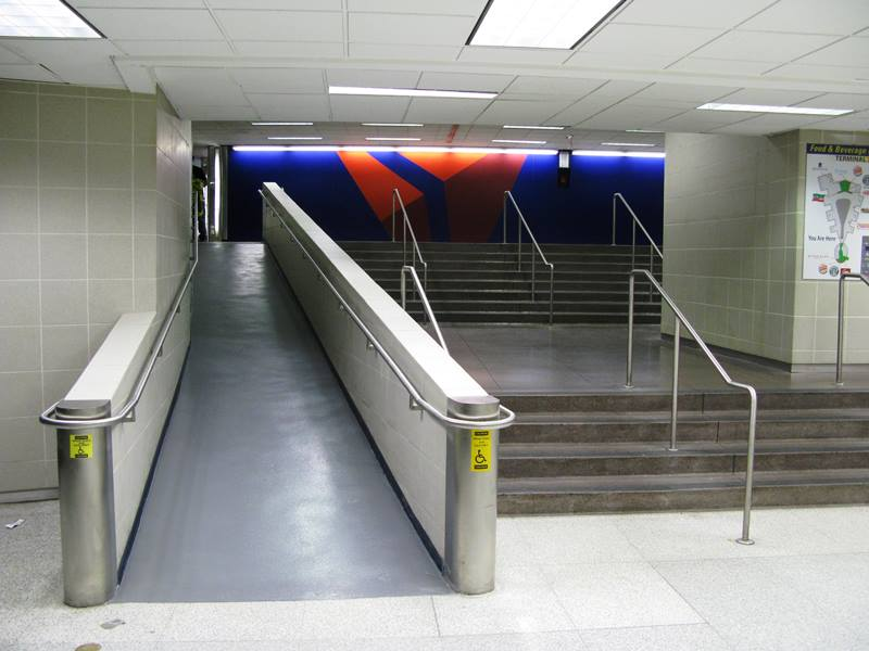 Wheelchair access ramp floor repair at an airport - airport facilities maintenance